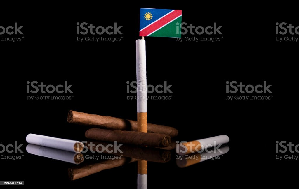 Namibian flag with cigarettes and cigars. Tobacco Industry concept. royalty-free stock photo