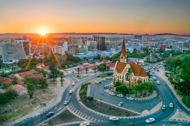 Namibia's Capital at Sunset Aerial view of downtown Windhoek, Namibia, featuring the city's historic Christ Church. namibia stock pictures, royalty-free photos & images