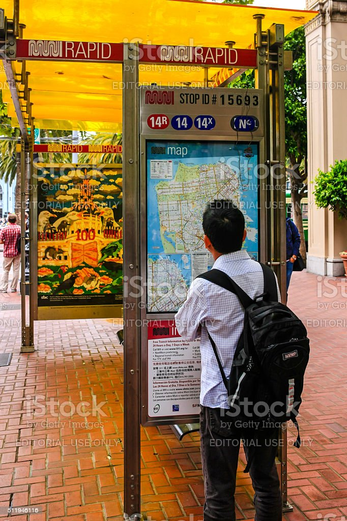Nan reading the tram system map in San Francisco CA stock photo