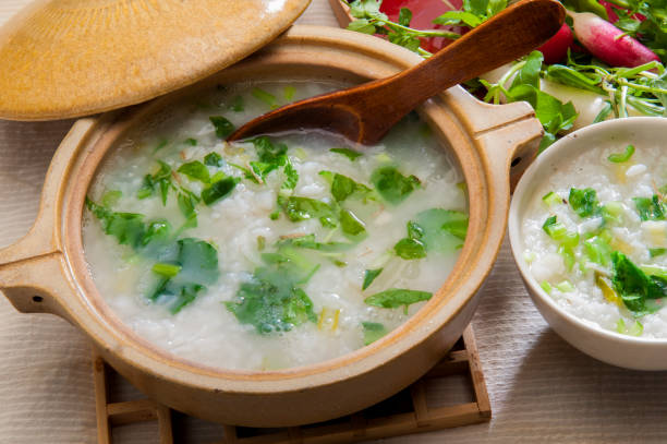 Nanakusa Porridge toraditinal Japanese New Year dish Nanakusa porridge is a traditional Japanese new year. After the New Year, we eat porridge with seasonal mountain grasses, called seven herbs of spring. shepherd's purse stock pictures, royalty-free photos & images