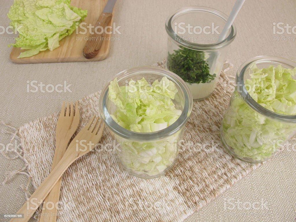 Napa cabbage salad in glass with yogurt dressing stock photo