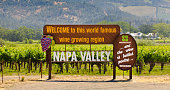 The road sign entrance of the vineyard and winery in Napa valley, California. Welcoming tourists and visitors to the famous wine country, the winemaking industry and agri-business in California.