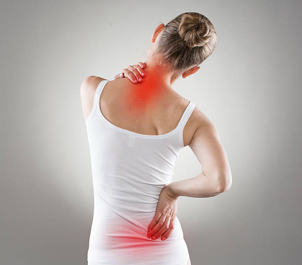 Nape pain Spine osteoporosis. Scoliosis. Spinal cord problems on woman's back. back pain stock pictures, royalty-free photos & images