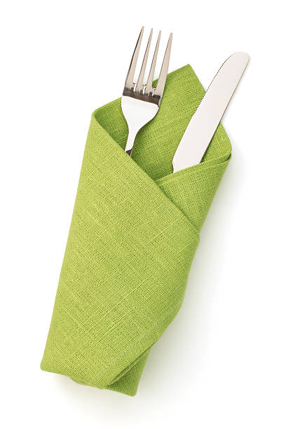 napkin, fork and knife isolated on white stock photo