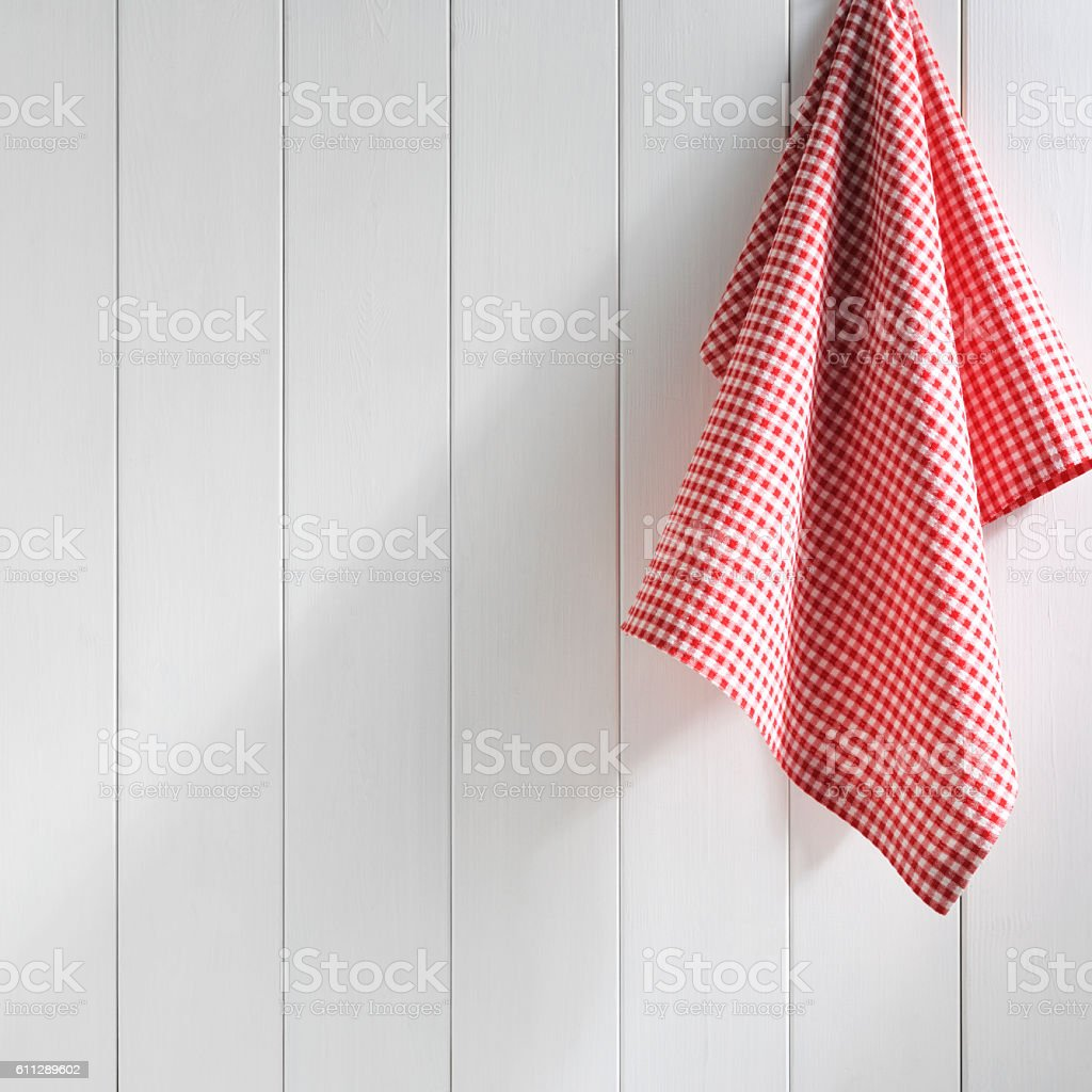 napkin hanging on white wall stock photo
