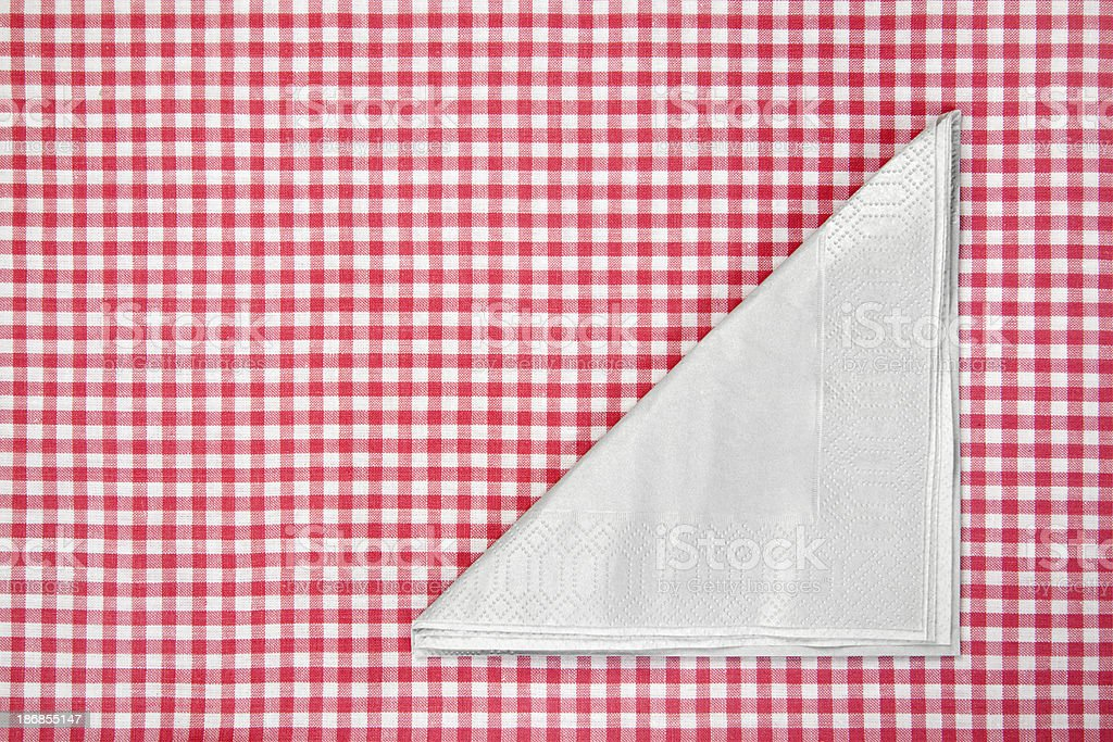 Napkin on red tablecloth royalty-free stock photo