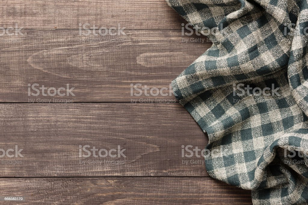 Napkin on the wooden background. Top view stock photo