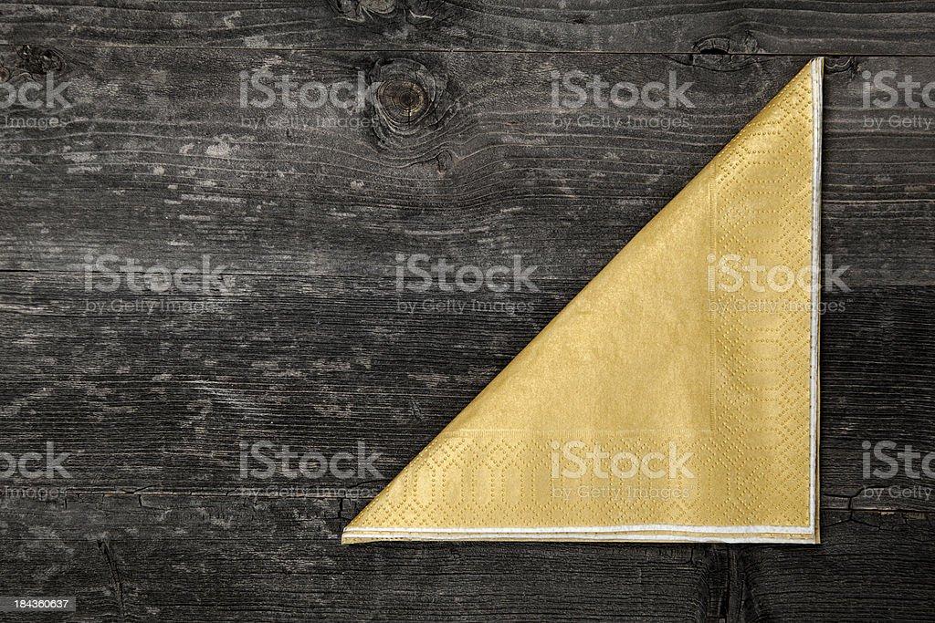 Napkin on wooden table royalty-free stock photo