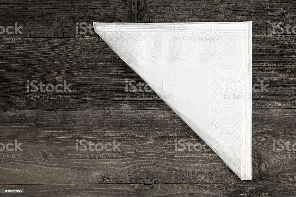 Napkin on wooden table royalty-free stock photo