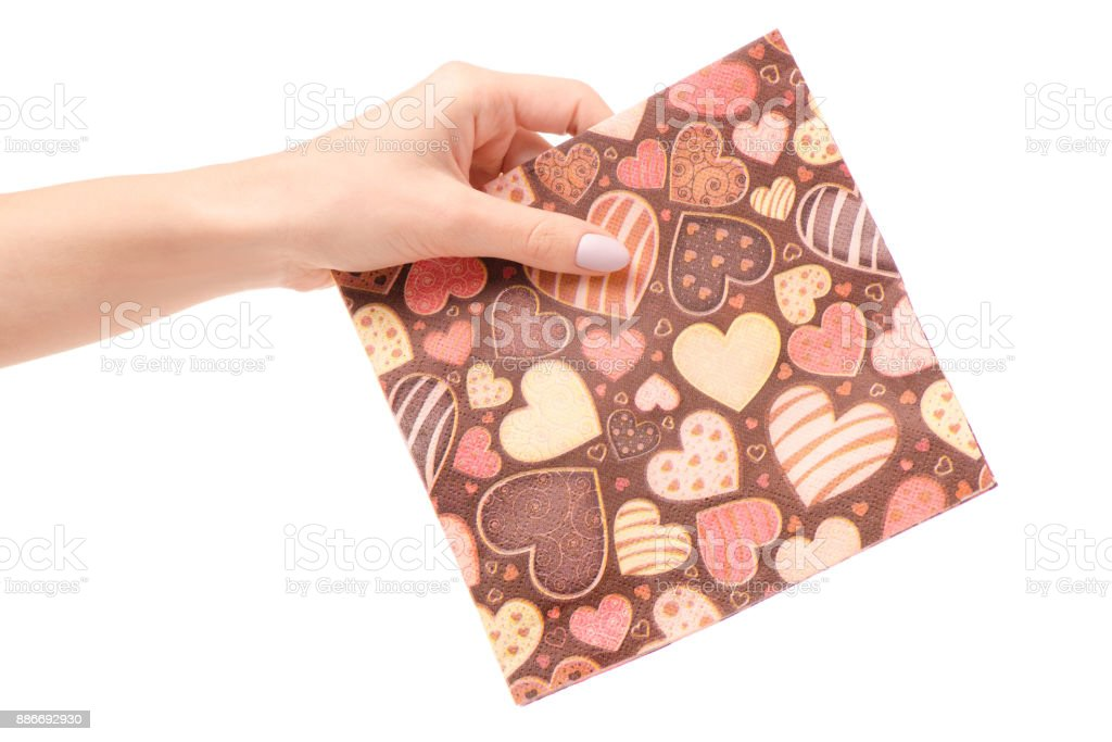 A napkin with heart pattern in hand stock photo