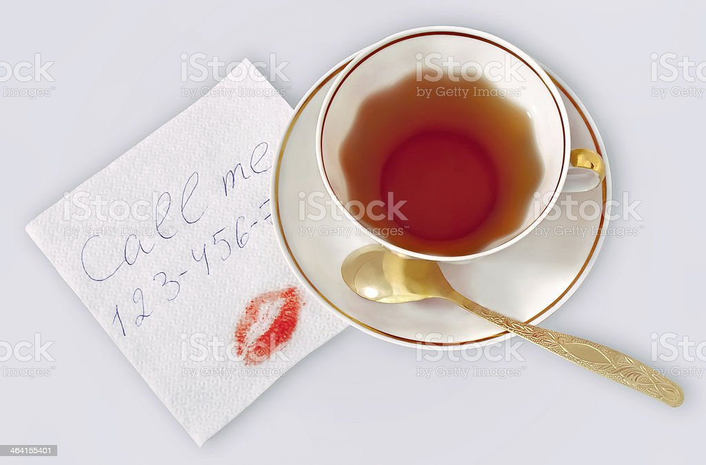 Napkin with phone number and kiss. stock photo