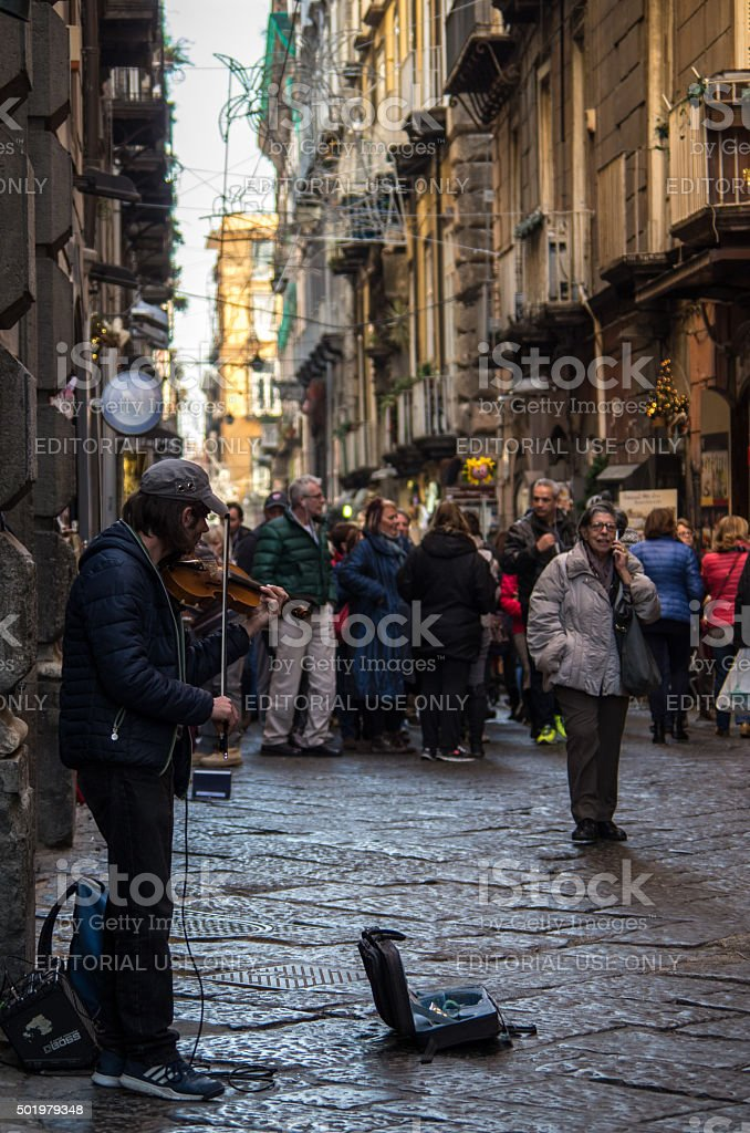 Naples, A violinist is playing in Benedetto Croce Street stock photo