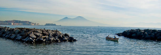Naples and mount Vesuvius in the background at sunset in a summer day, Italy, Campania stock photo
