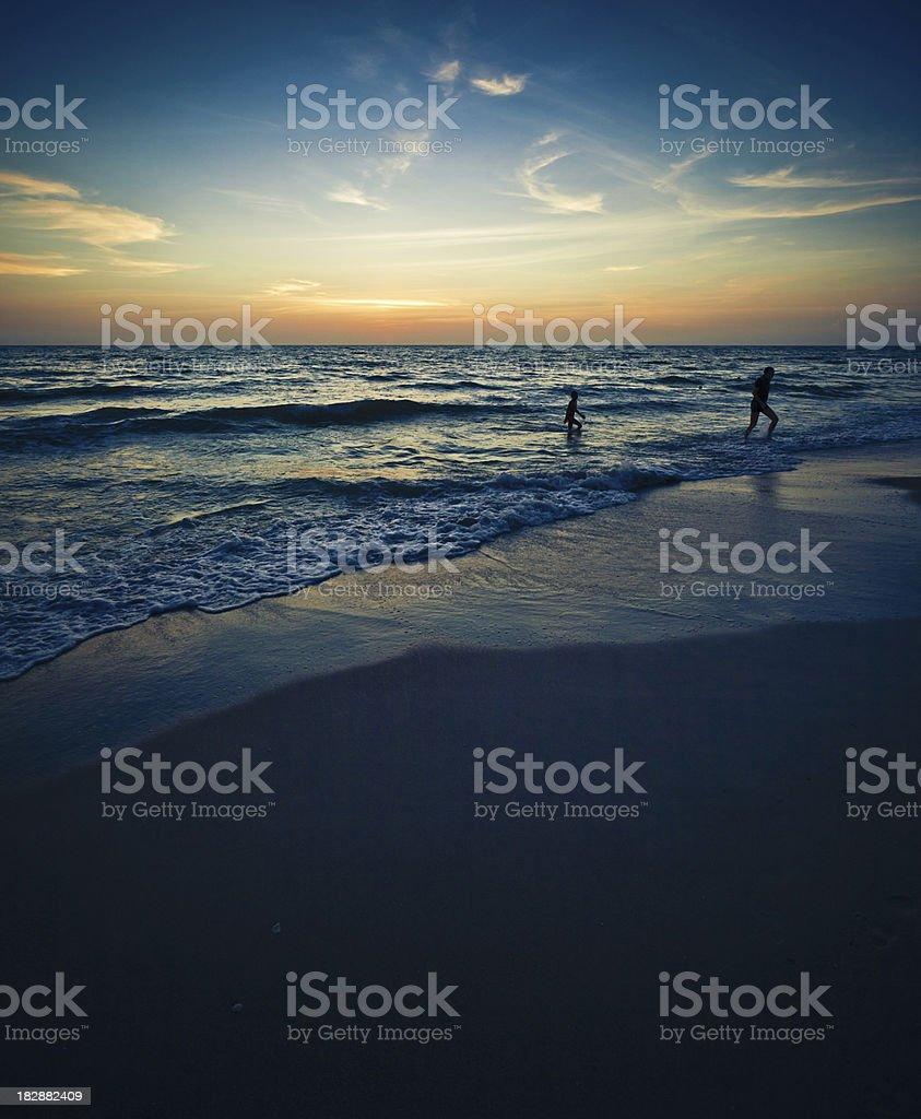 naples beach at sunset stock photo