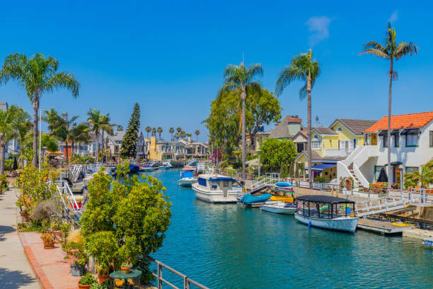 Naples beach houses on canal in Long Beach, California beach house with water, beach house with palm trees, Long Beach beach house, Beach house with boats, calm water, turqouise water, Naples - Long Beach, California long beach california stock pictures, royalty-free photos & images