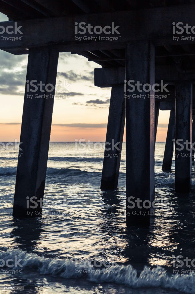 Naples beach pier at dusk stock photo