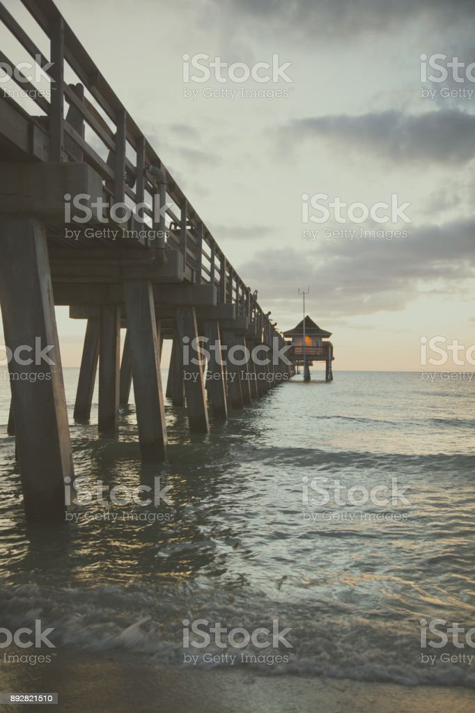Naples beach pier stock photo