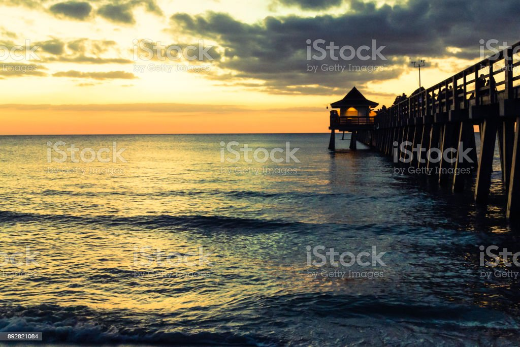 Naples beach with pier stock photo