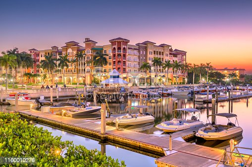 Naples, Florida, USA town skyline on the water at dawn.