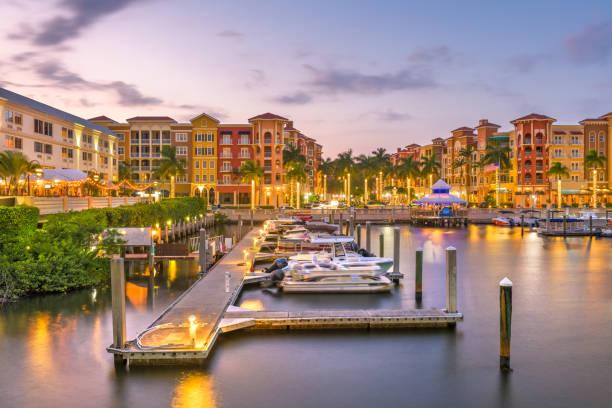Naples, Florida, USA town skyline Naples, Florida, USA town skyline on the water at dusk. naples florida stock pictures, royalty-free photos & images