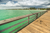 Fishing rod along the Naples Pier on the Gulf of Mexico in Florida USA
