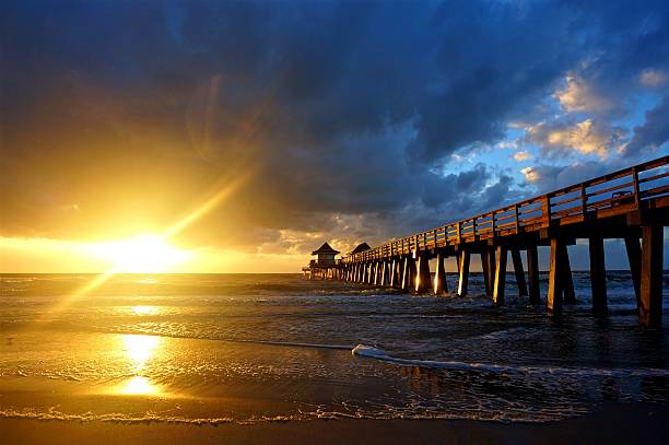 Naples Pier Sunset A popular tourist attraction place in Naples, Florida. Picture taken in 2016. naples florida stock pictures, royalty-free photos & images