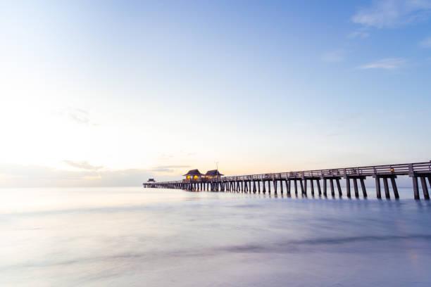 Naples Pier Sunset Pier Naples SunSet Art Florida naples florida stock pictures, royalty-free photos & images