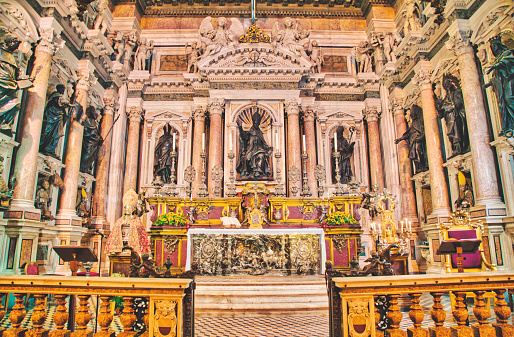 View of one altar in the Naples Cathedral or The Cathedral of the Assumption of Mary, (Italian: Duomo di Napoli, Cattedrale di Santa Maria Assunta or Cattedrale di San Gennaro; Neapolitan: Viscuvato 'e Napule) is a Roman Catholic cathedral, the main church of Naples, southern Italy, and the seat of the Archbishop of Naples. It is widely known as the Cattedrale di San Gennaro, in honour of Saint Januarius, the city's patron saint.. Naples, is the regional capital of Campania and the third-largest city of Italy, after Rome and Milan, with a population of almost 1million. It's the second-most populous metropolitan area in Italy and the 7th-most populous urban area in the European Union. In 1995, the historic center of Naples was listed by UNESCO as a World Heritage Site.