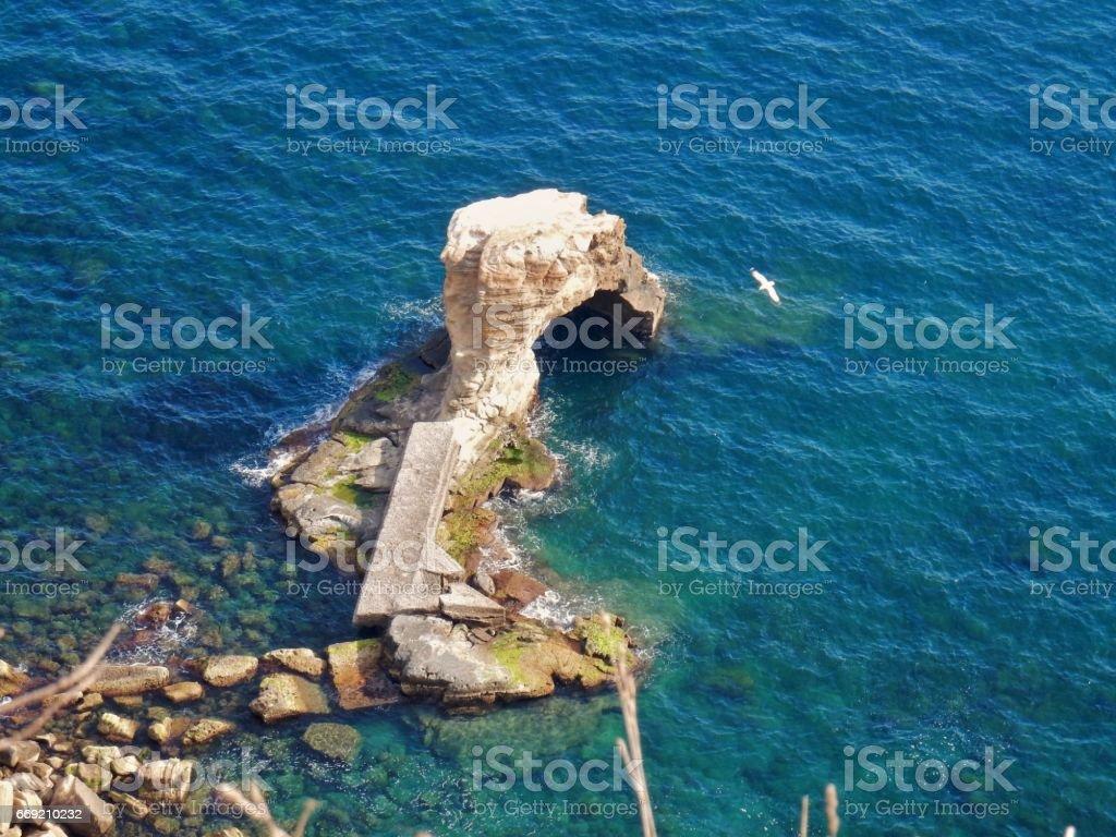 Napoli - Scoglio nella Baia di Trentaremi stock photo