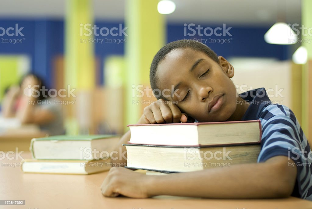 Napping at the library royalty-free stock photo