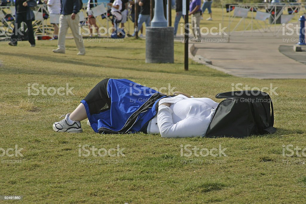 Napping in the park royalty-free stock photo