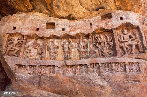 istock Narasimha and other Hindu gods in natural cave in Badami town, India. Temple carvings made in 6th century 688935578