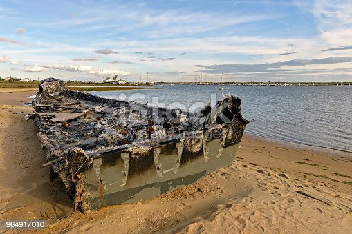 Narco power boat burnt and abandoned on the coasts of Huelva, Spain.