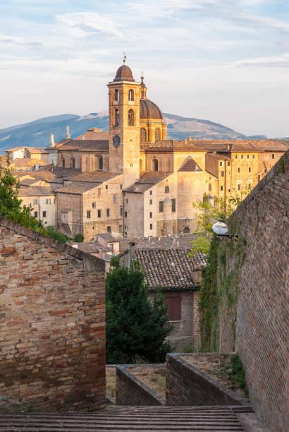 Narrow alley in the city center of Urbino stock photo