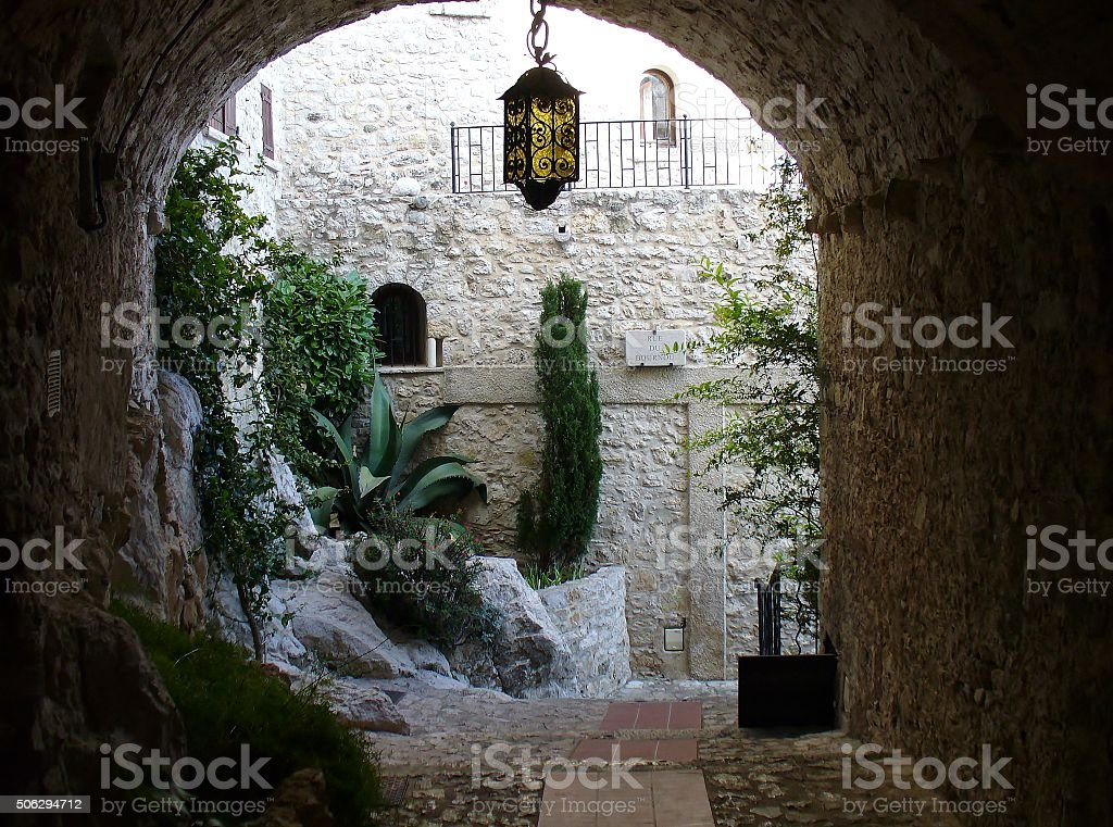 Narrow alley in village of Eze. France. stock photo