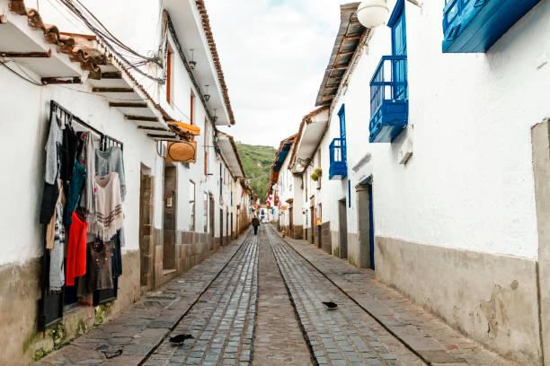 Narrow alley of the San Blas neighborhood (Cusco, Peru) with shops stock photo