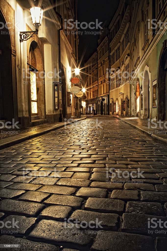 narrow alley with lanterns in Prague at night royalty-free stock photo