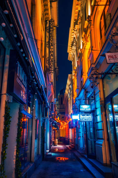 Narrow alley with night clubs and cocktail bars for entertainment stock photo