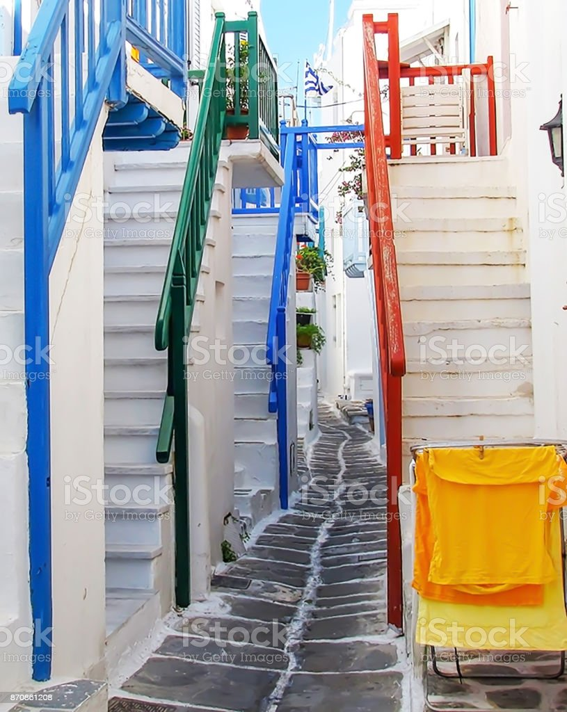 Narrow Alleyway Surrounded by Steep Stairs with Brightly Colored Railings stock photo