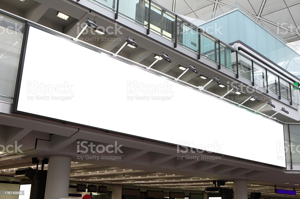Narrow and long blank white billboard at airport stock photo