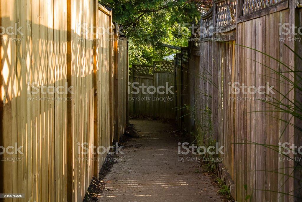 Narrow backyard path stock photo
