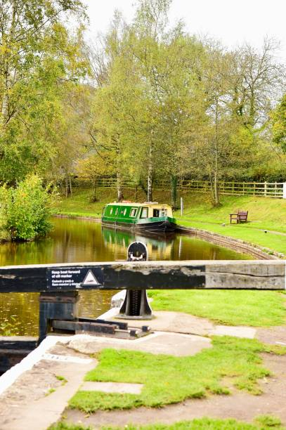 Narrow boat on am UK canal A canal boat on the Monmouthshire and Brecon Canal brecon beacons stock pictures, royalty-free photos & images