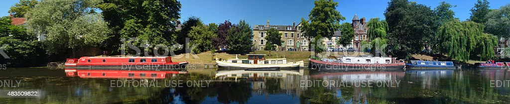 Narrow boats and Barges on the river Cam stock photo