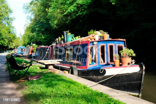 Barges and Narrow Boats on the Kennet and Avon Canal near Bath in Somerset England