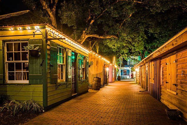 Narrow brick alley at night, in St. Augustine, Florida. stock photo