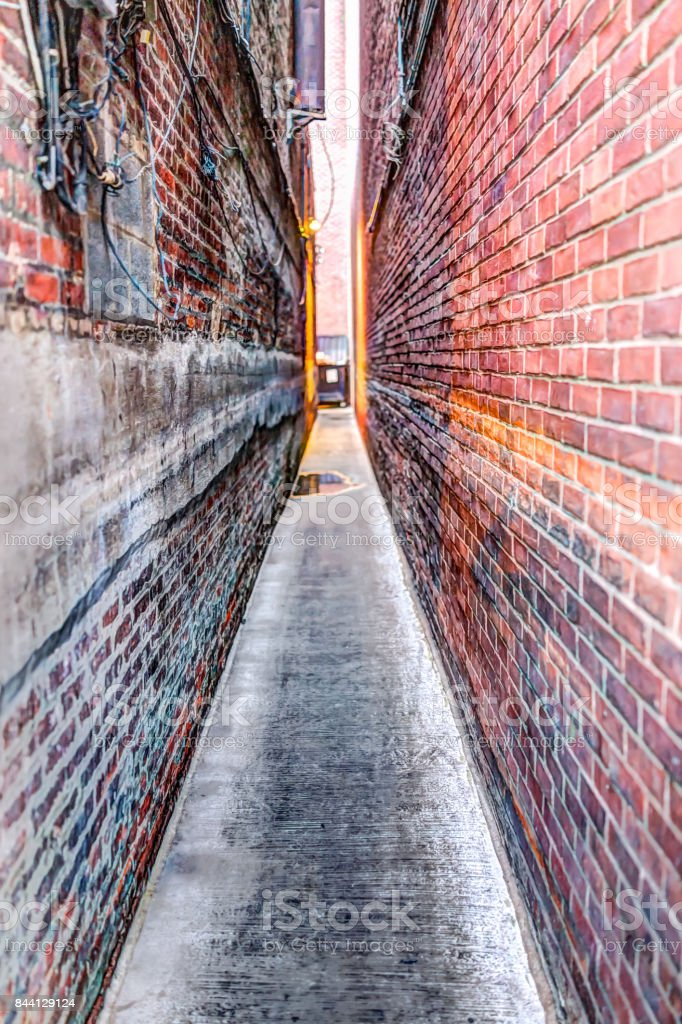 Narrow Brick alley in Georgetown, Washington DC with vintage grunge look and illuminated lights stock photo