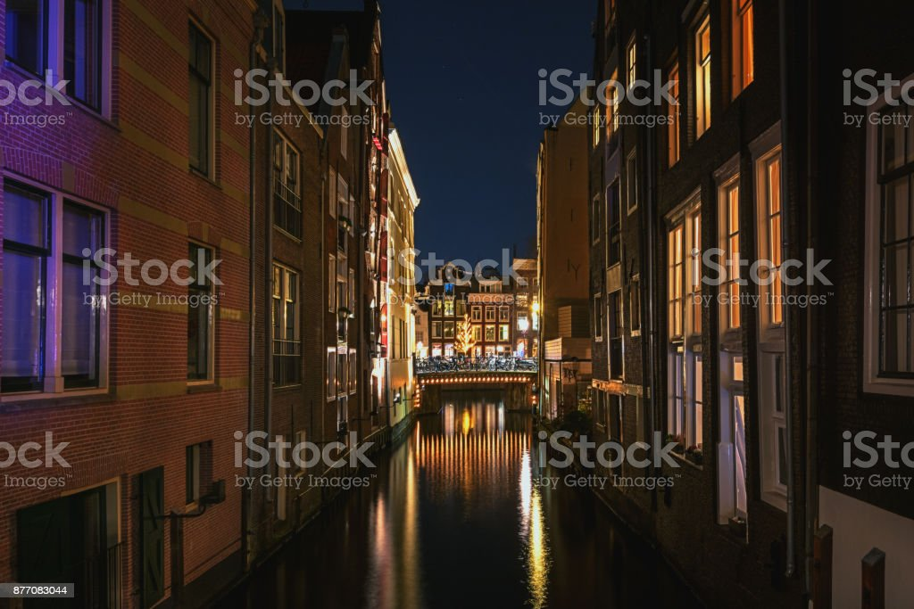Narrow canal in the old town of Amsterdam stock photo