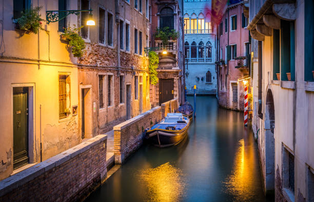 Narrow canal in Venice in the evening stock photo