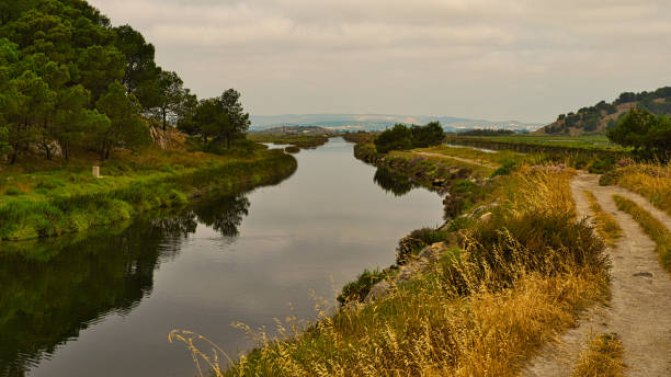 Narrow canal winding into the distance stock photo