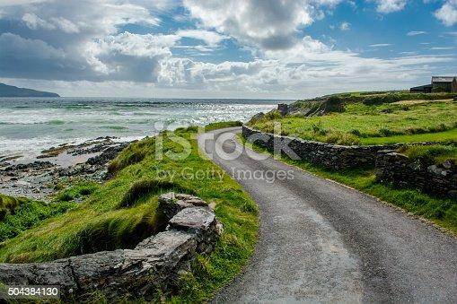 istock Narrow Coastal Road in Ireland 504384130